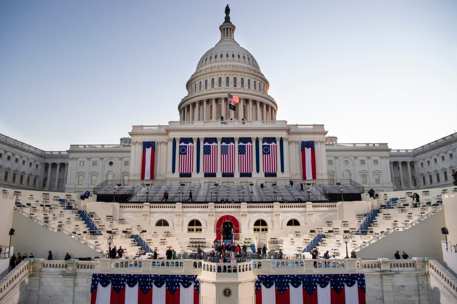 The sun rises behind the U.S. Capitol as preparations are made for the 59th inaugural ceremony for President-elect Joe Biden and Vice President-elect Kamala Harris on the West Front of the U.S. Capitol in Washington on Wednesday, morning. (Caroline Brehman/Pool Photo via AP)