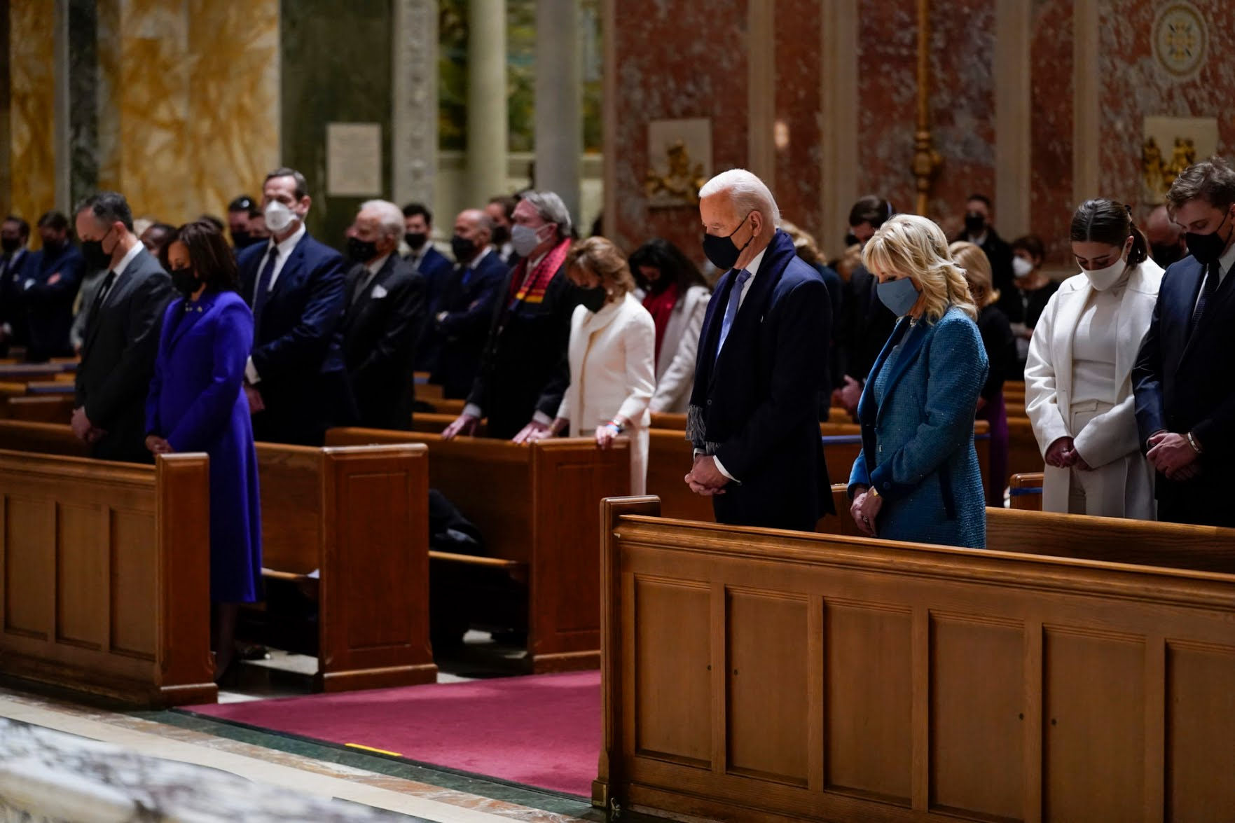 The Bidens attend Mass at the Cathedral of St. Matthew the Apostle on Wednesday morning ahead of the inauguration ceremony. Harris and her husband Doug Emhoff are at left. (Evan Vucci/AP)